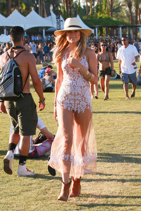Remember that posh Made in Chelsea lass Kimberley? Well here she bloody is at Coachella, looking like an actual summer's day in this gorge sheer lacy dress and big ol' fedora hat. Dreamy. <br /><br />