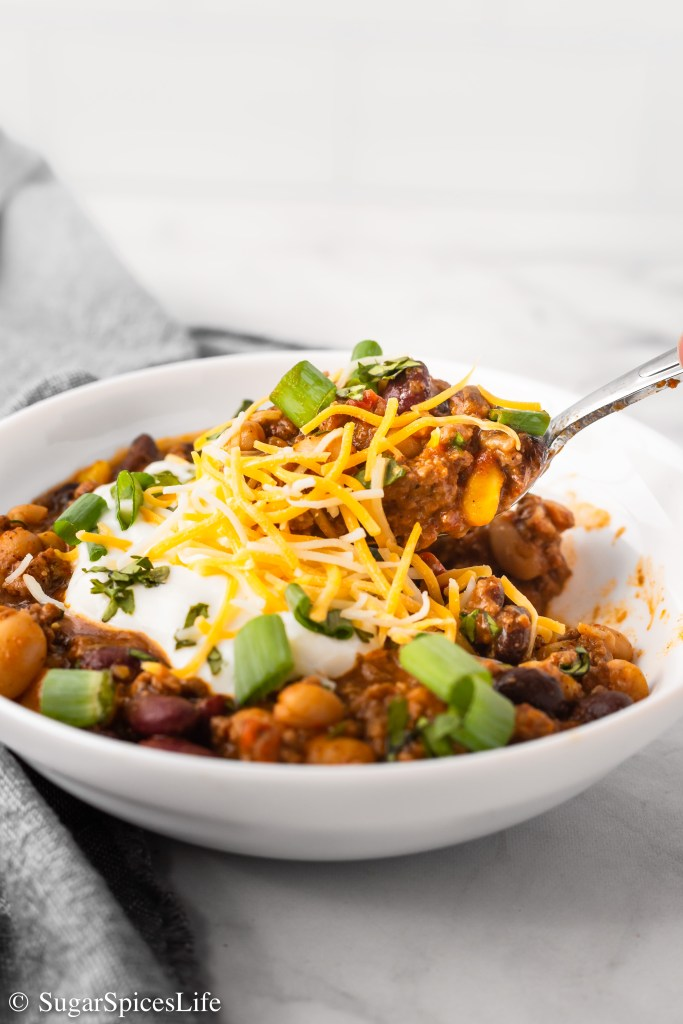 Perfectly seasoned beef cooked with beans, vegetables, and flavorful spices. This Easy Beef and Bean Chili can be made on the stove top or in an Instant Pot for a warm, comforting weeknight meal!
