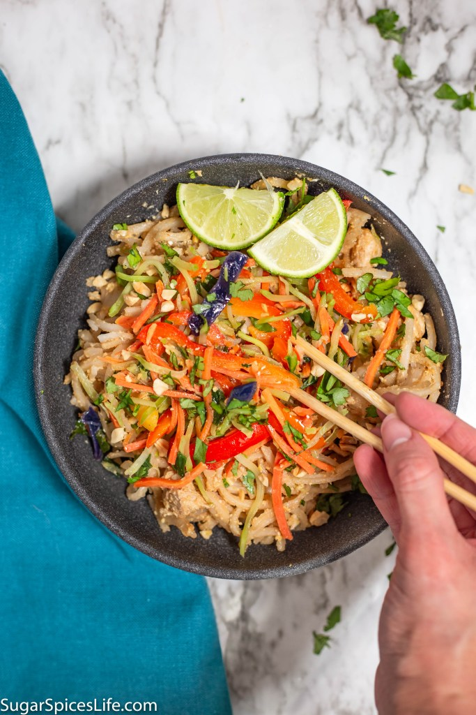 Asian Noodles with Peanut Sauce. Rice noodles with chicken and egg, mixed with peanut sauce, and topped with stir fried vegetables. Full of flavor and easy to make. No fish sauce or seafood!