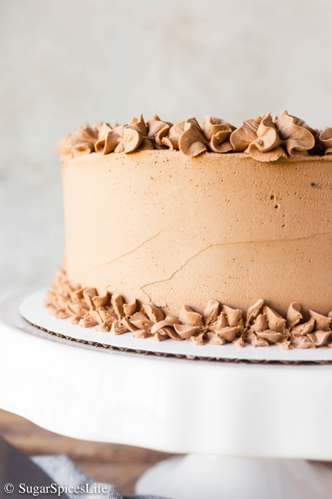 This Churro Cake has soft ,cinnamon cake layers with a rich praline filling, and a buttercream frosting with melted dark and white chocolates mixed in. This is hands down one of the best cakes you will ever eat.