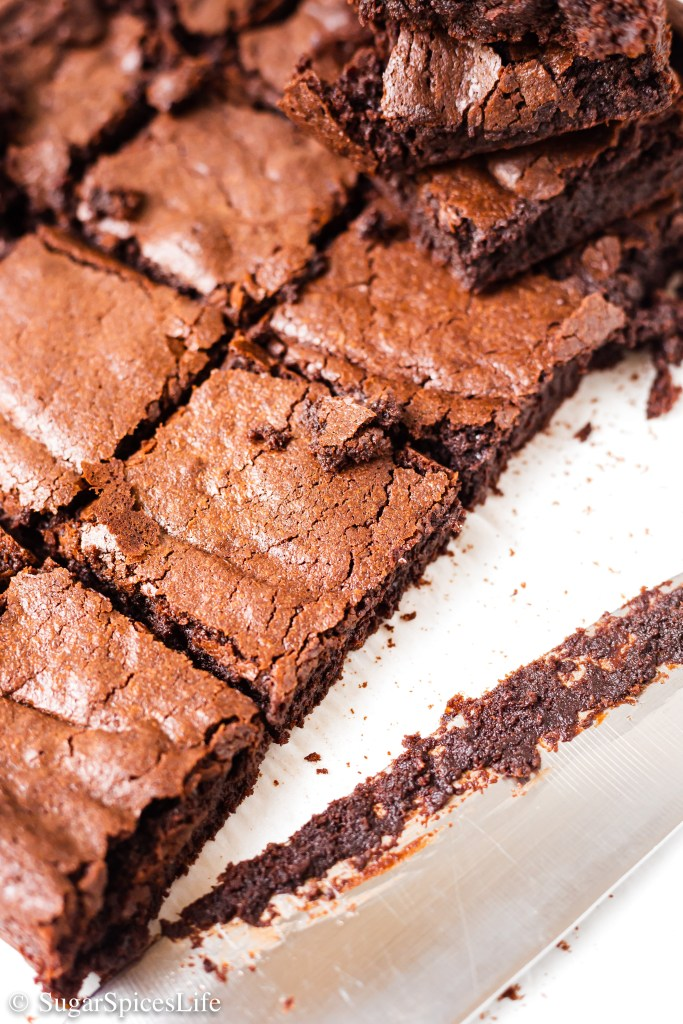 These Crispy Top Fudgy Brownies are soft and fudgy with a crispy, sweet top. Baked in parchment paper so that even the sides are soft and chewy. Addictively delicious.