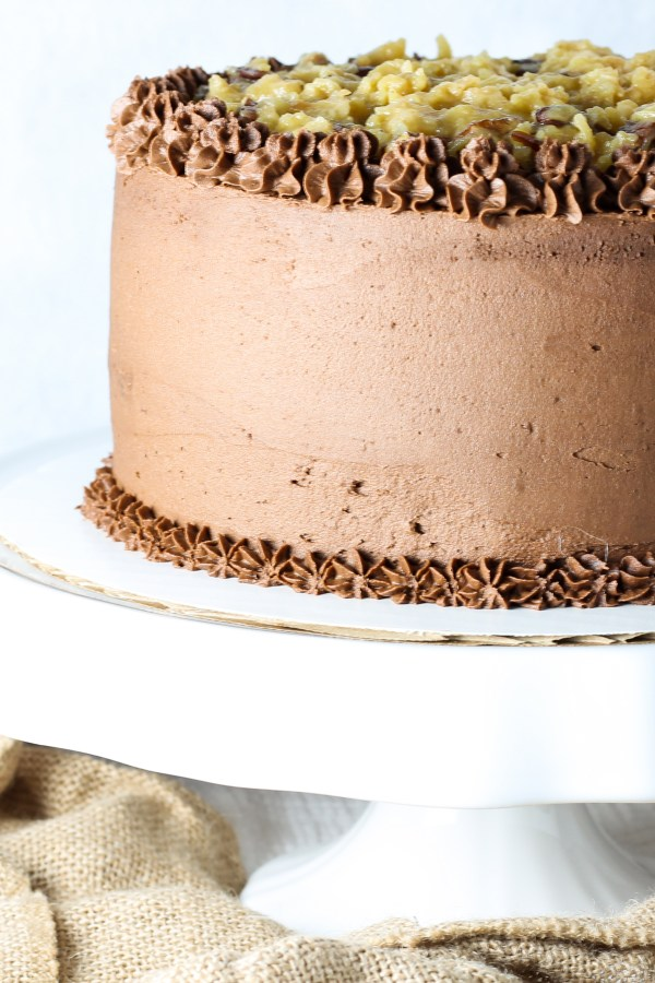 German Chocolate Cake. A moist, sweet chocolate cake with a toasted coconut and pecan filling, and topped with rich chocolate buttercream. This cake is the stuff cake dreams are made of.