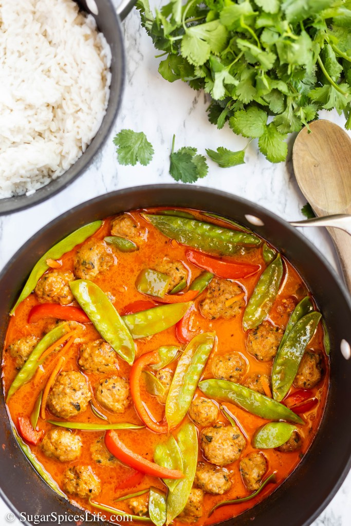 Curry Meatballs with Coconut Rice. Chicken curry meatballs in a coconut curry sauce with vegetables, served over coconut rice. Easy to make and amazingly delicious.