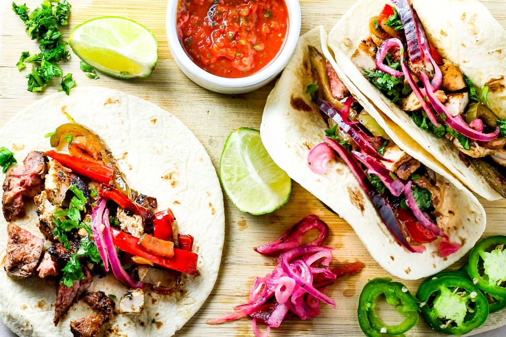 Grilled Cilantro Lime Chicken Tacos. Chicken marinated in a cilantro, lime sauce and grilled to perfection. Then, put in a tortilla, topped with grilled vegetables and pickled red onions, making it the perfect taco.