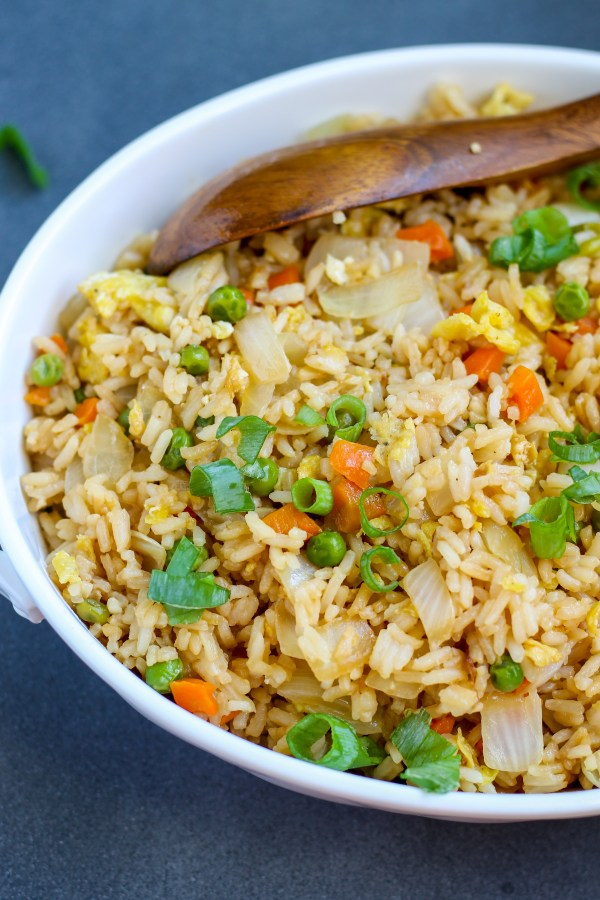 Honey Garlic Pork with Fried Rice. Pork in a delicious honey, garlic sauce over the easiest, best fried rice. A meal as good as an Asian restaurant in under an hour at home!