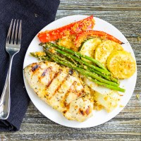 Grilled Lemon Chicken with Panko Crusted Vegetables. Chicken marinated in a lemon dressing and grilled to perfection. Served with panko crusted vegetables and a lemon honey sauce. Vegetables have never tasted so good.