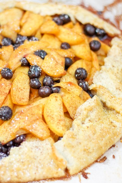 Peach Blueberry Tart. Almond pastry filled with fresh peaches and blueberries, and a hint of nutmeg and cinnamon. This dessert is beautiful, easy to make, and devinely tasty.
