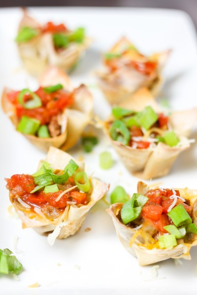 Wonton Taco Cups. Taco beef in a wonton taco shell, topped with cheese, salsa and your favorite taco toppings. Easy and quick to make. Perfect for a snack, appetizer, or party food!