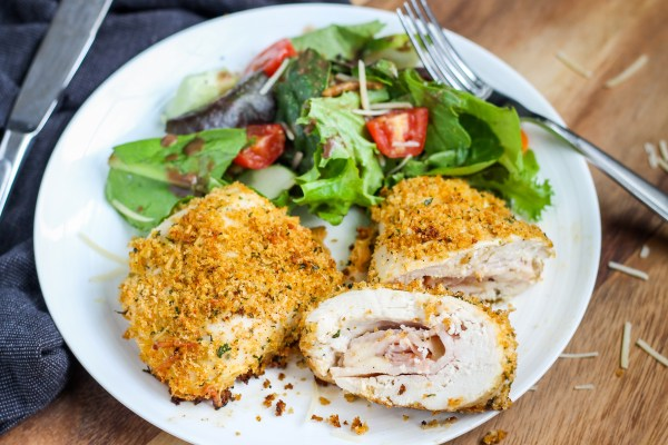 Bacon Chicken Cordon Bleu. Chicken stuffed with ham, swiss cheese, and bacon, then rolled in a deliciously spiced panko mixture. A tasty twist on chicken cordon bleu!