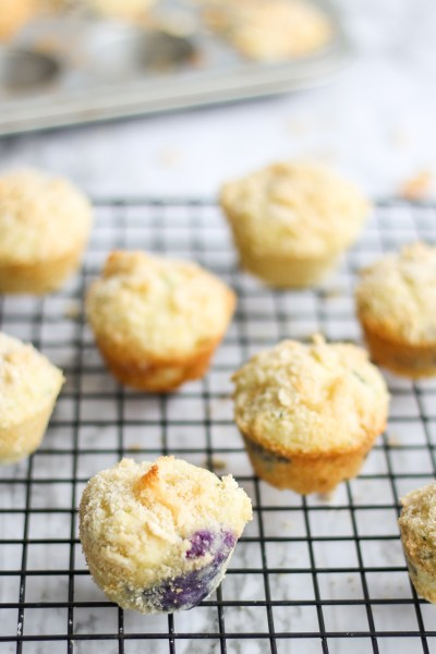Blueberry Zucchini Muffins. These mini muffins are made with zucchini, a mix of all purpose and coconut flours, and blueberries. Finished with a streusel topping, they are delicious!