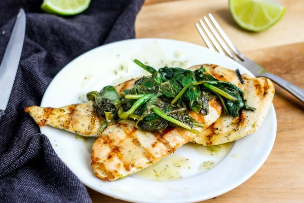 Grilled Chicken with Lime Butter Sauce. Chicken marinated in a garlic lime sauce, grilled, and topped with spinach and a delicious lime butter sauce. Quick to put together and full of flavor!