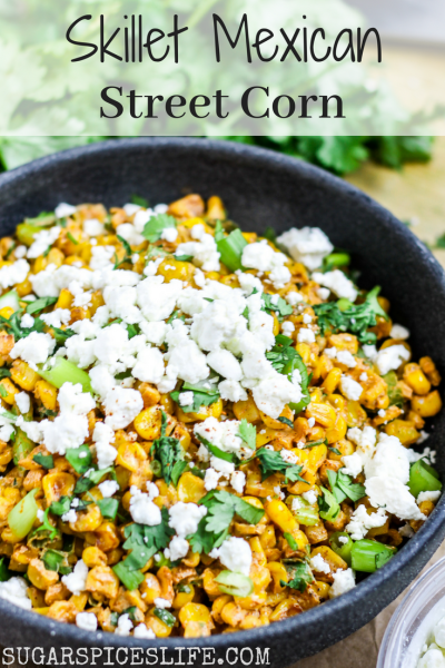 Skillet Mexican Street Corn. Corn roasted in a skillet, coated in a creamy spicy lime sauce, and topped with goat cheese and onions. The best way ever to eat corn.