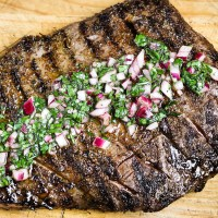 Deliciously seasoned flank steak grilled to your desired temperature, then topped with a tasty chimichurri sauce. This Flank Steak with Chimichurri Sauce is quick to make but sure to impress!