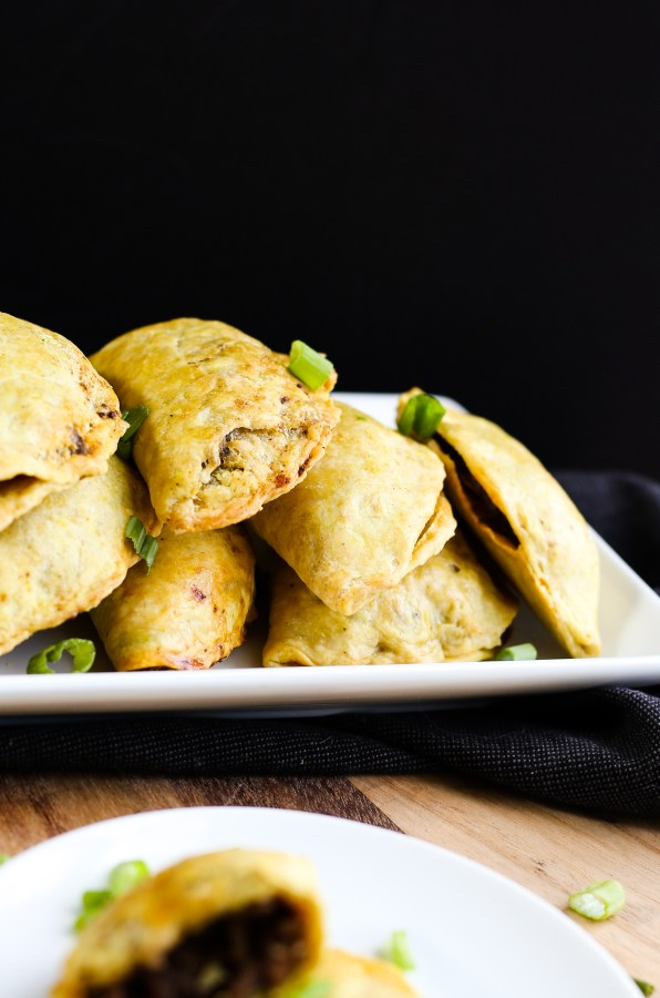 Jamaican Beef Patties. Curry spiced dough filled with deliciously seasoned beef and vegetables, baked to a perfect crisp.