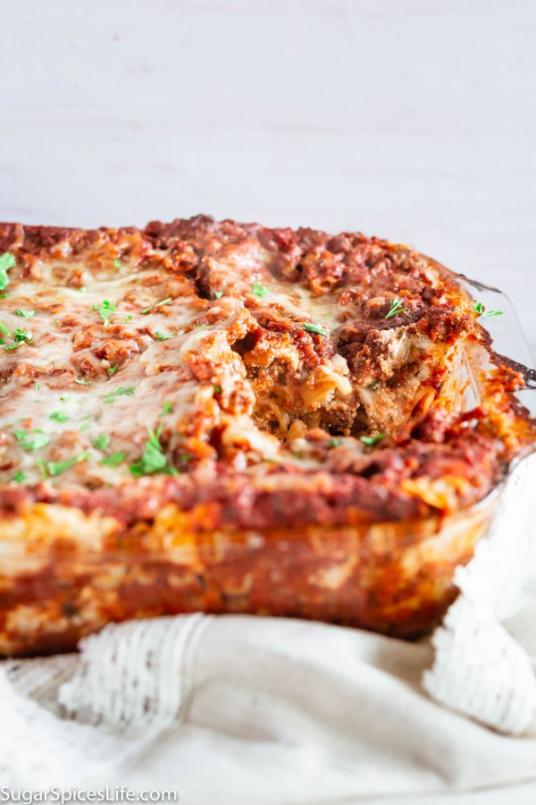 Sausage and Beef Lasagna. Layers of perfectly seasoned beef and sausage tomato sauce with melty, tasty cheeses! Lasagna kicked up a notch!