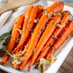 Honey Roasted Carrots. Carrots roasted with a honey butter glaze, fresh herbs, and shallots. Soft, sweet, and delicious!