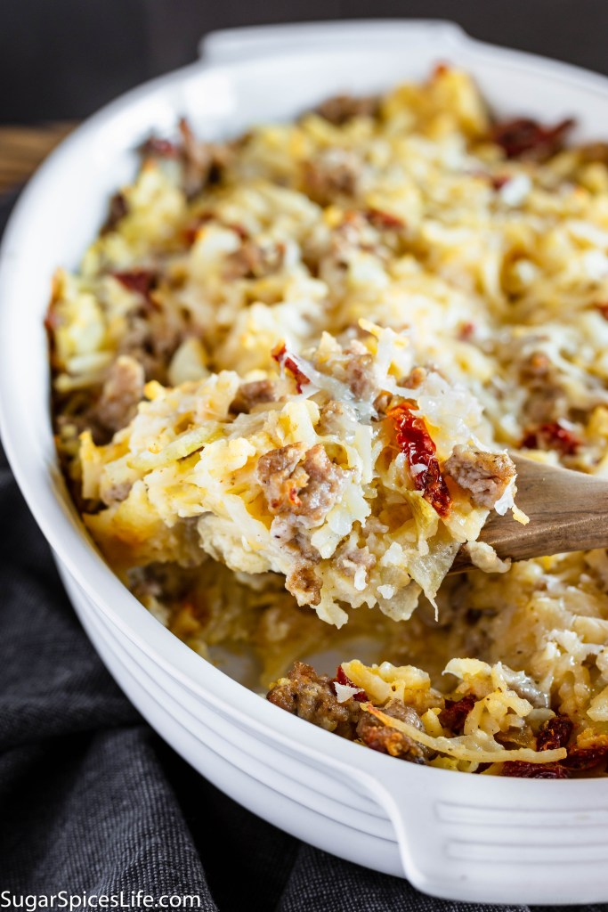 Italian Breakfast Casserole. Hash browns, sun dried tomatoes, Asiago cheeses, and eggs baked together to make the perfect morning casserole! Easily prepared ahead of time.
