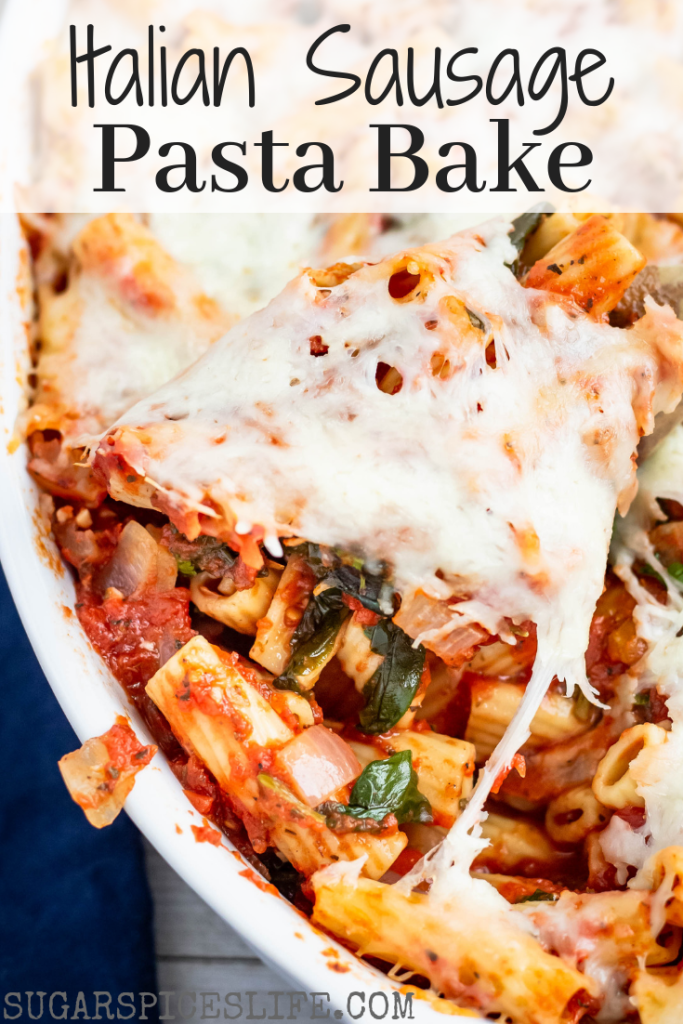 This Italian Sausage Pasta Bake starts with rigatoni noodles in a homemade marinara sauce mixed with Italian chicken sausage, sauteed spinach and onions, and topped with lots of melted cheese. Quick, easy, and delicious!