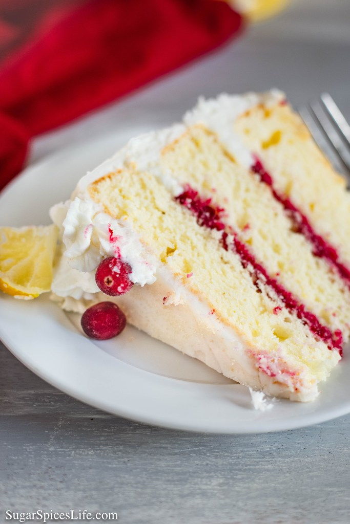 This Lemon Cranberry Cake has moist, lemon cake layers with a sweet cranberry filling and finished with white chocolate buttercream.