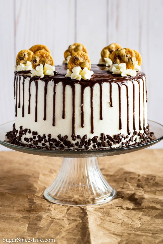 This Milk and Cookies Cake has chocolate chip filled vanilla cake layers, a chocolate chip cookie dough filling, and a creamy buttercream frosting. It's milk and cookies turned into a cake!