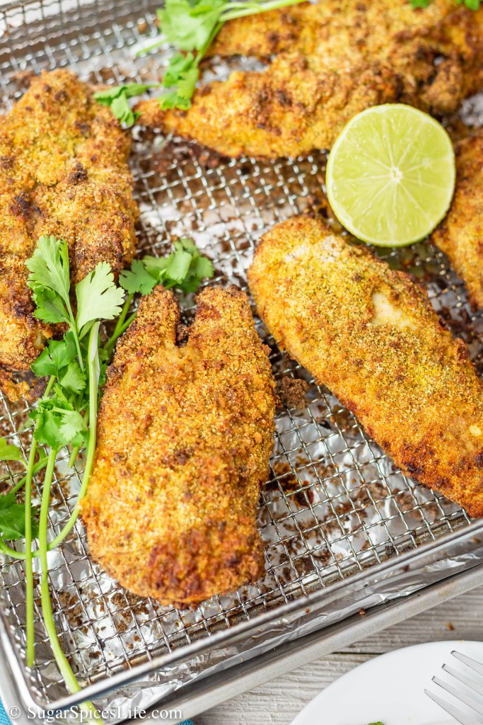 Chicken with a crunchy, Caribbean spiced coating and topped with a lime yogurt sauce. This Jamaican Fried Chicken is deliciously seasoned and can be made in an air fryer or oven.