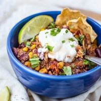 Chicken, beans, and vegetables cooked with a mesquite flavoring and finished with a bit of honey. This Slow Cooker Mesquite Chicken Chili tastes like a honey BBQ chip turned into a chili!
