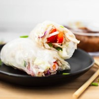 Fresh vegetables, juicy chicken, and rice noodles rolled up in rice paper and dipped in a creamy peanut butter sauce. These Spring Rolls are quick and healthy, yet filling and delicious.
