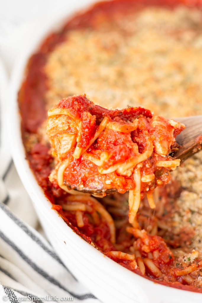 Chicken baked with noodles in a homemade marinara sauce, and topped with a breadcrumb parmesan topping. This Chicken Parmesan Casserole is pure comfort food!