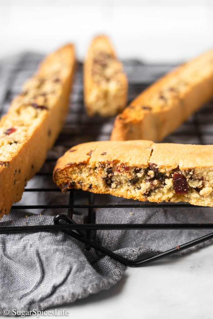 Lightly orange flavored biscotti filled with dried sweetened cranberries and chocolate chips. This Orange Cranberry Biscotti is a crispy, delicious treat for breakfast, a snack, or dessert!
