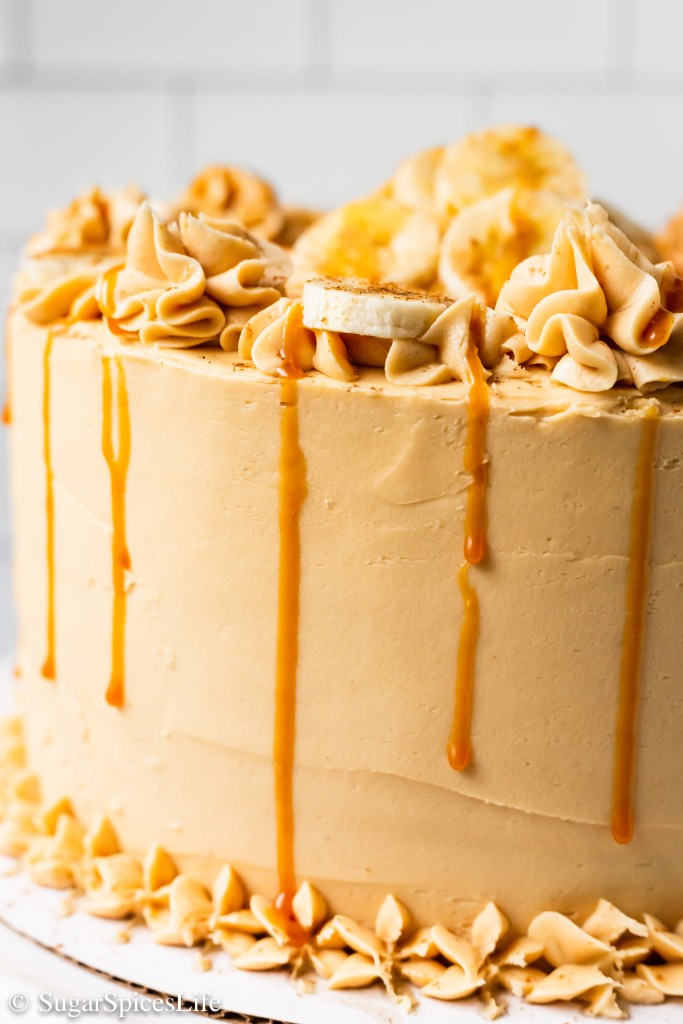 Soft, cinnamon cake layers with a bananas foster flavored filling and caramel rum frosting. This Bananas Foster Cake will take your dessert game to a new level!