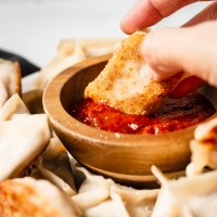 Deliciously seasoned beef and cheese wrapped in a wonton wrapper, then pan fried to have a perfectly crisp bottom. Dip these Lasagna Style Potstickers in marinara sauce for a dinner that the whole family will love!