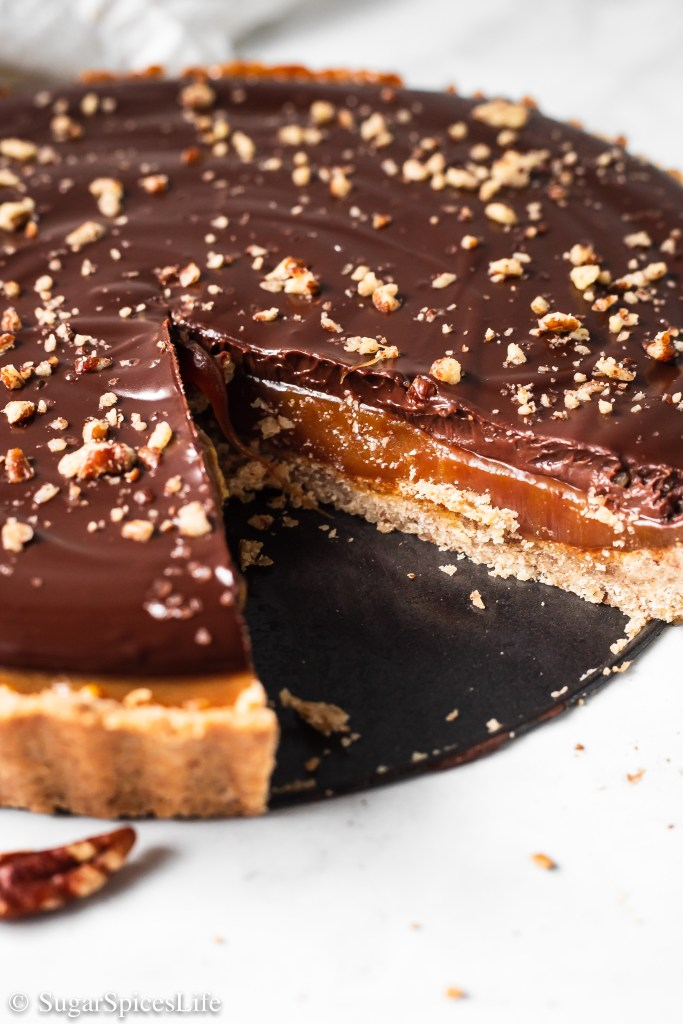 A toasted pecan crust with a rich caramel filling, topped with a dark chocolate glaze. This Salted Caramel Tart is a beautiful, delicious dessert that is sure to impress!