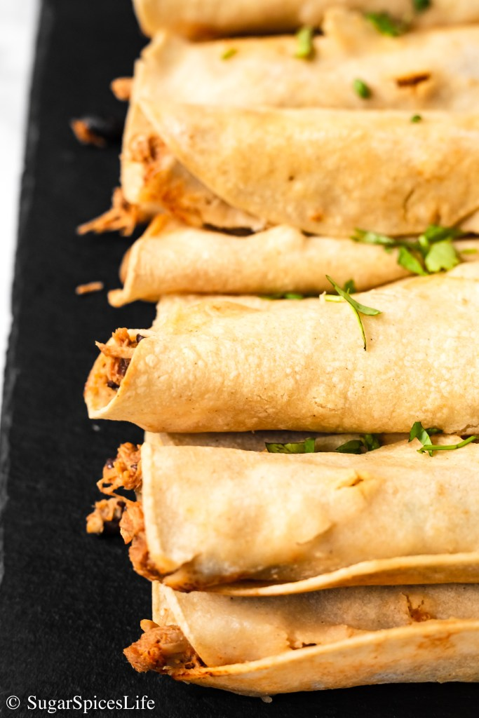 Chicken cooked in Kinder's® Tequila Lime Rub, mixed with salsa verde, beans, and cheese, and baked in a corn tortilla. These Tequila Lime Chicken Taquitos are a healthier, delicious spin on taquitos!