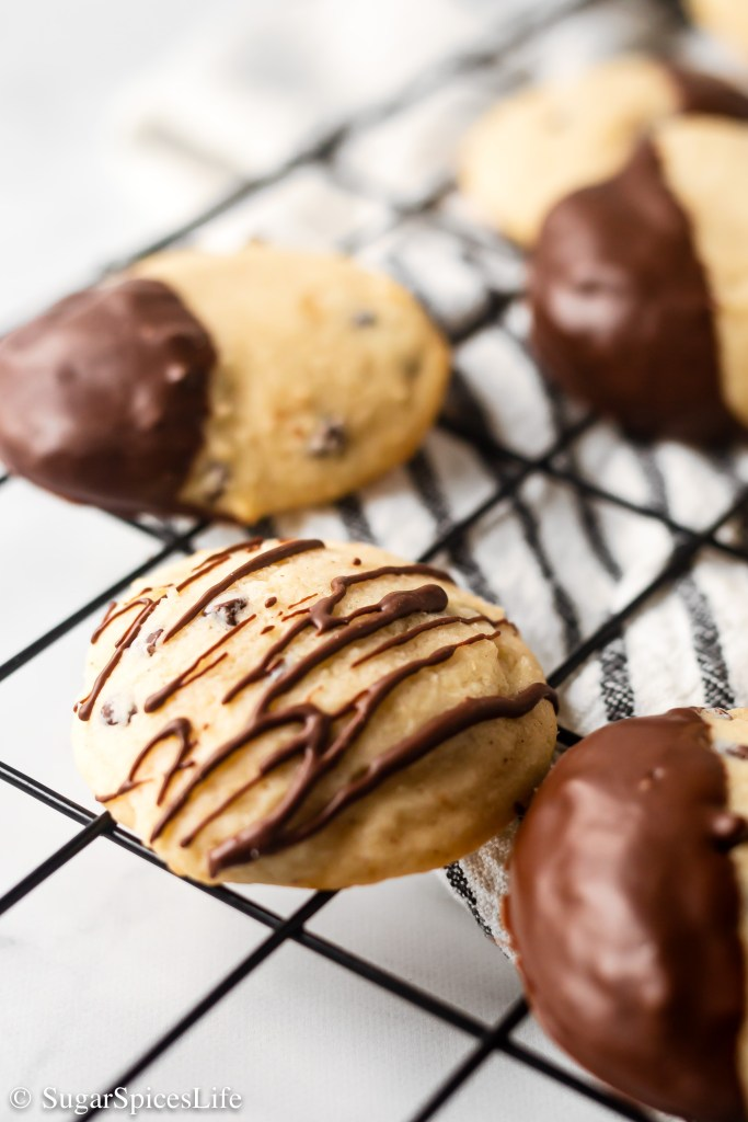 Soft, fluffy ricotta cookies filled with mini chocolate chips and finished with melted semi-sweet chocolate. These Cannoli Cookies are a unique, delicious treat!