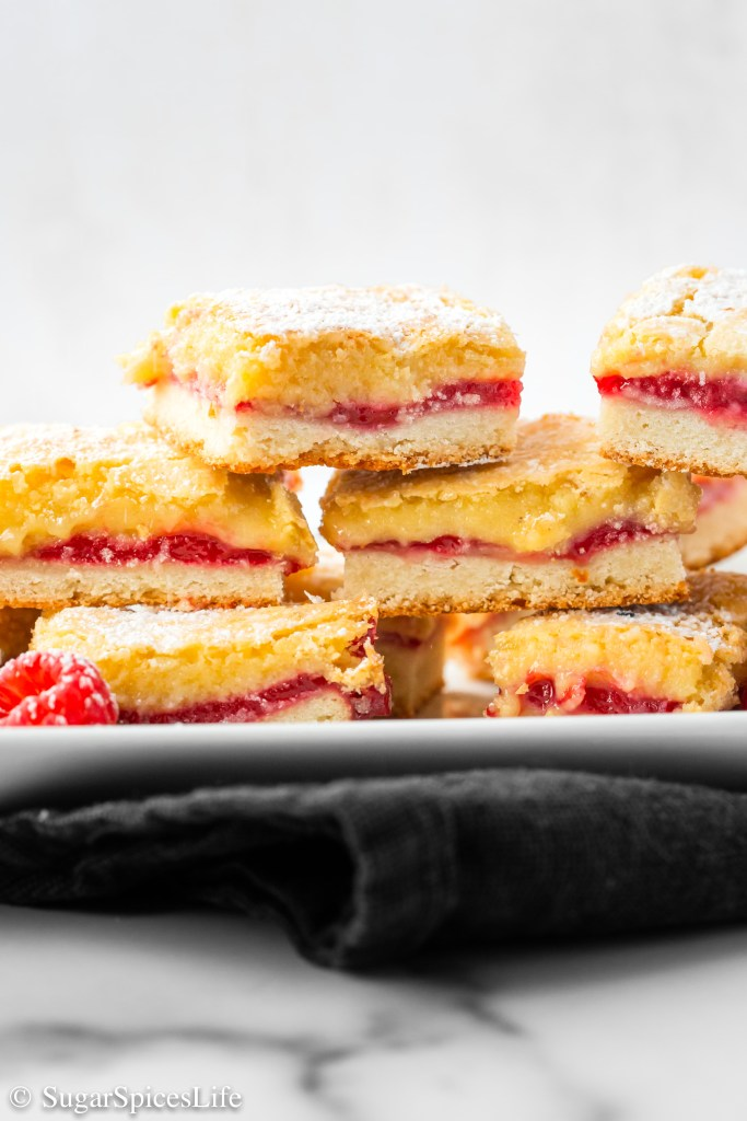 A flaky almond, pastry crust topped with a raspberry jam and almond paste topping. These Raspberry Almond Bars are a uniquely delicious treat!