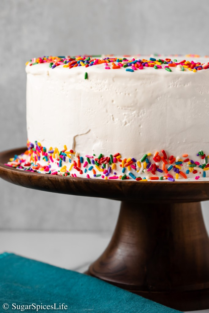 Chocolate fudge and chocolate cookie crumbs sandwiched between vanilla and strawberry ice creams, then finished with frozen whipped topping. This Homemade Neapolitan Ice Cream Cake is easy to customize and ridiculously easy to make!