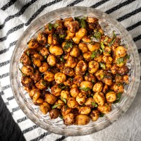 Chickpeas roasted in the oven and then tossed with lemon juice, a homemade spice mix, and parsley. These Spicy Roasted Chickpeas are a wonderful appetizer or snack!