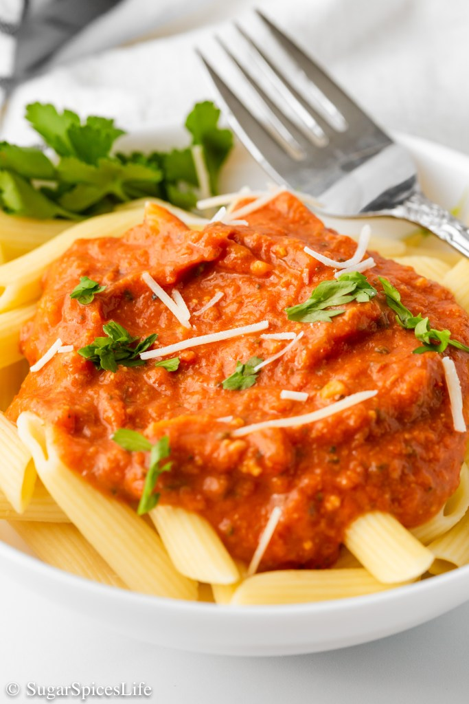 Creamy tomato sauce made with coconut milk, vodka, and tons of flavor. This Less Dairy Vodka Sauce is perfect for anyone wanting to cut down a bit on dairy without sacrificing great taste!