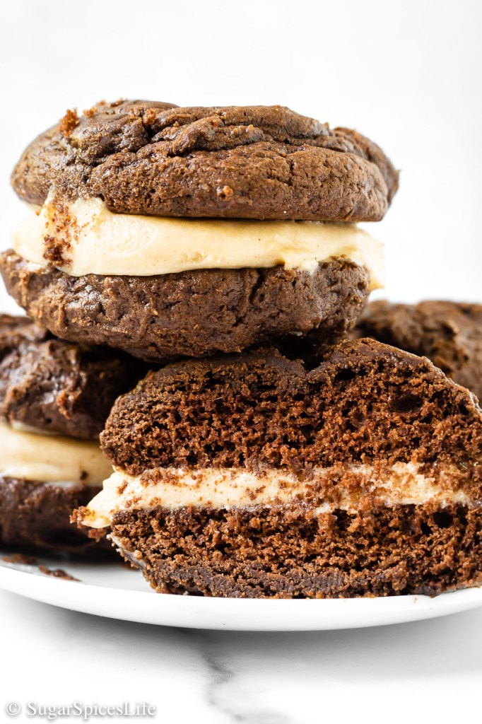 Two chocolate, cake like cookies with a sweetened peanut butter filling. These Peanut Butter Whoopie Pies are individually sized desserts that are perfect for sharing!