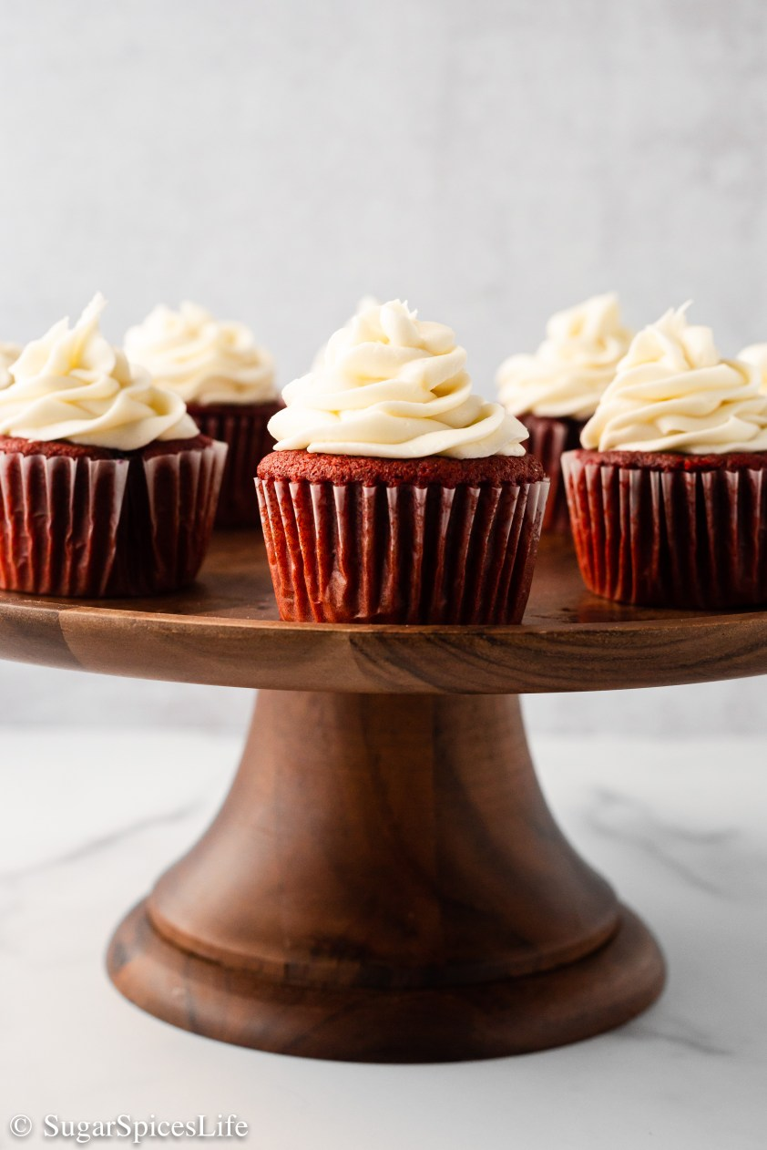 Soft, light cupcakes with a berry preserve filling and cream cheese frosting. These cupcakes are so tasty that no one would guess these Berry Filled Red Velvet Cupcakes start with a boxed cake mix.