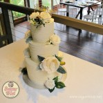 Buttercream lines with artificial flowers