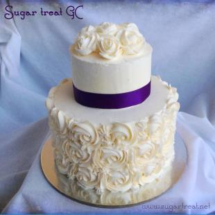Swirls, ribbon and piped roses
