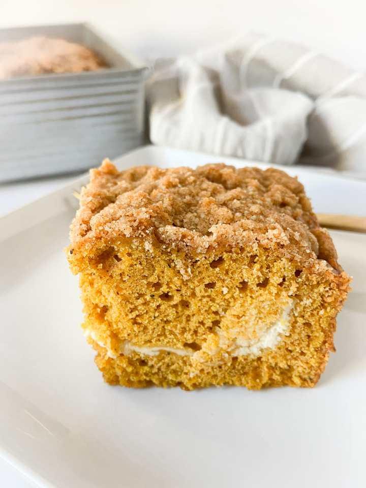 a slice of pumpkin cream cheese crumb cake