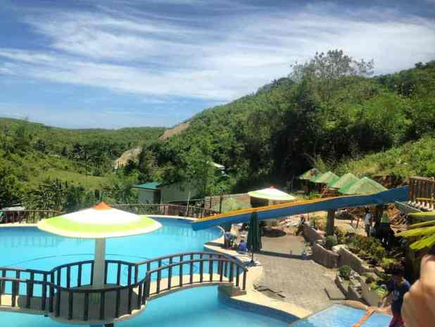 Paradise hills mountain resort with a massive pool in for Pool garden mountain resort argao
