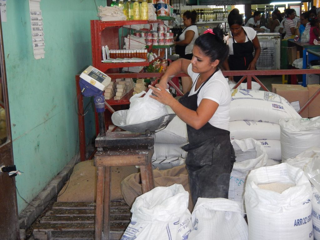 Measuring out flour at a local food market in Old Havana.