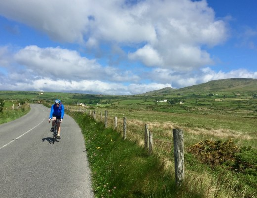 A cyclist on the beautiful Ring of Bear Cycle on Ireland's Wild Atlantic Way.
