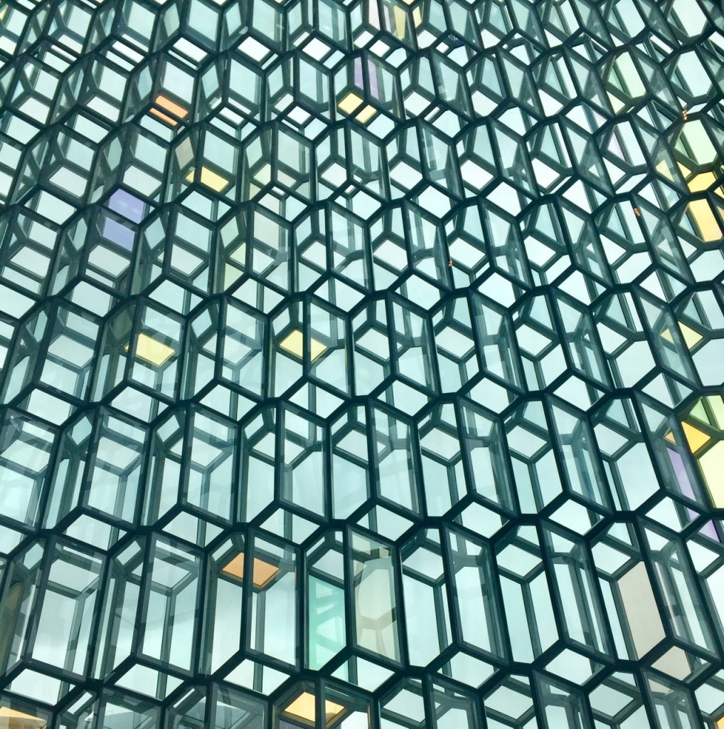 The beautiful multi-coloured glass facade of the Harpa Concert and Exhibition Centre in Reykjavik.