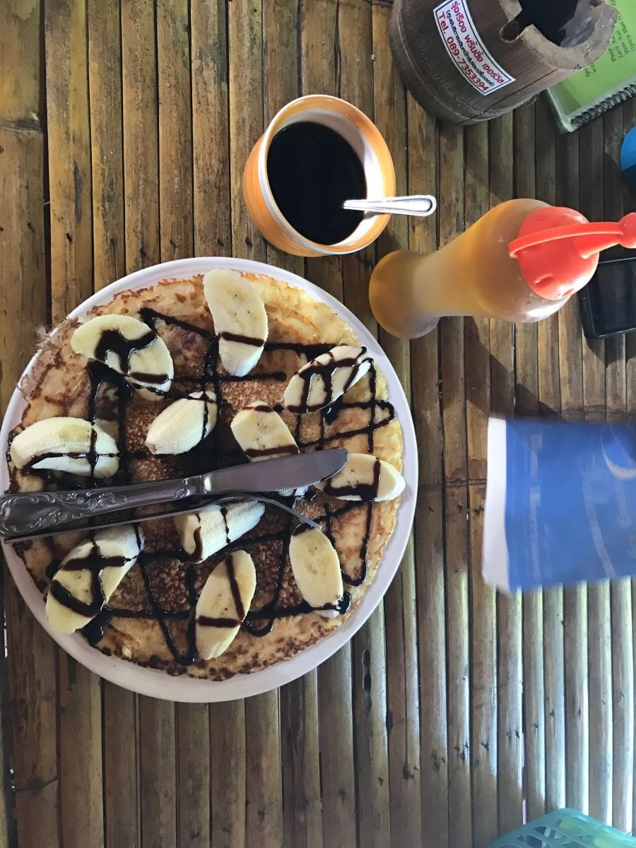 breakfast pancakes and coffee on a bamboo table