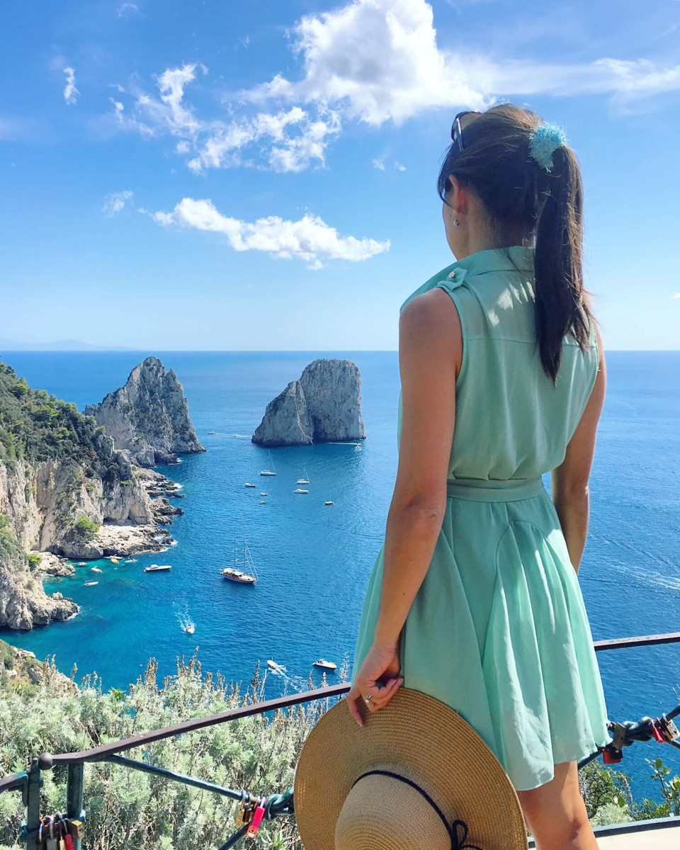 Jasmine looking out at the water and cliffs in Capri