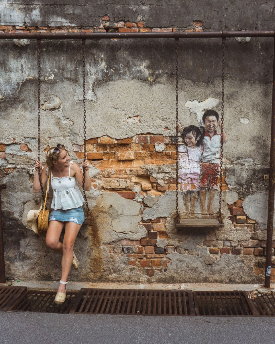 Frances in front of the Penang street art